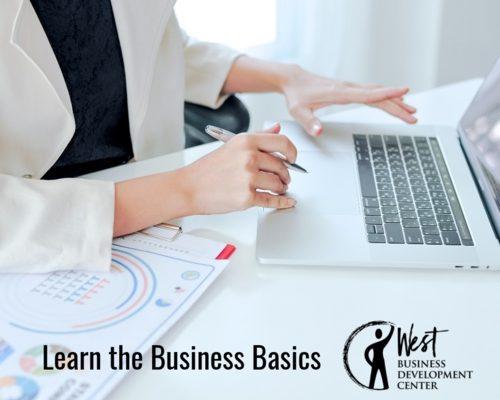 Image: Woman typing on keyboard, learning business basics