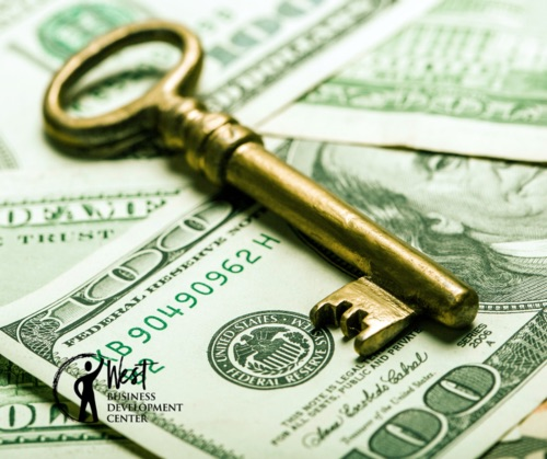 Image: Gold key on top of $100 dollar bills - Foundations of Finance workshop