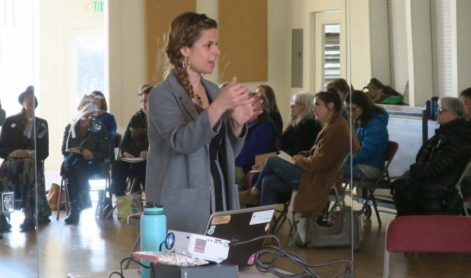 Image: Rachel Clark, Certified EMyth Business Coach, in front of audience at Coast Women in Business
