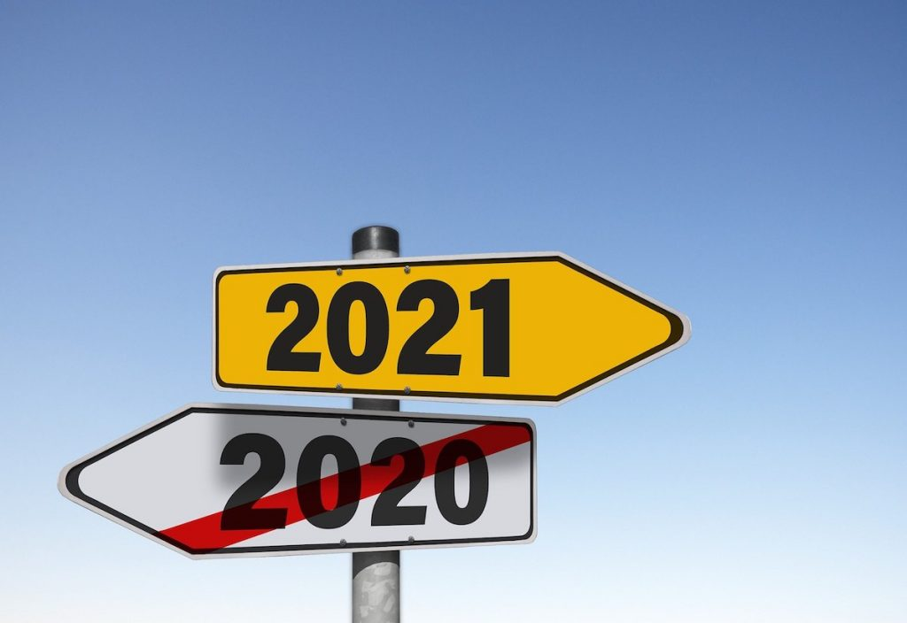 Signpost: 2020 pointing left, 2021 pointing right - Coast Women in Business
