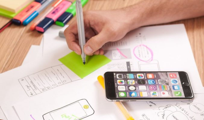 Image: Doodling on paper, next to iPhone - Coast Women in Business
