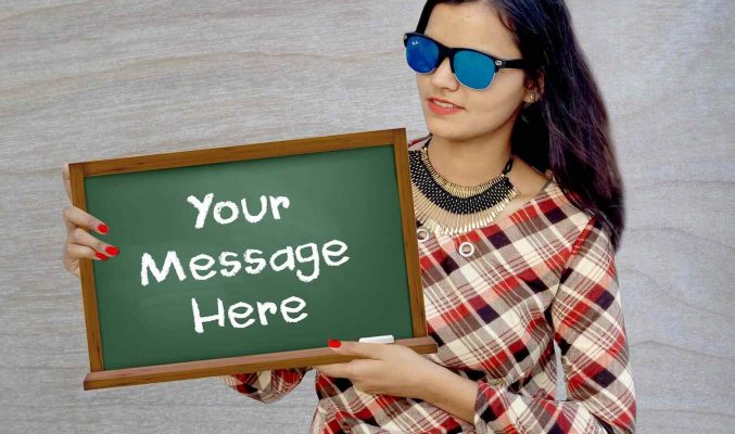 "Image: Woman holding sign ""Your Message Here"" - - Coast Women in Business"