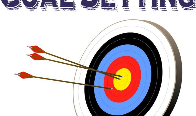 Image: Goal-setting above arrows in target - Coast Women in Business