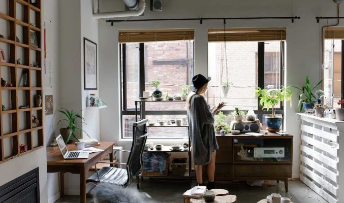 Image: Woman standing in home office - Coast Women in Business