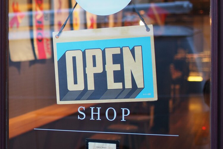 """Image: Shop with """"open"""" sign - Retail Roundtable"""